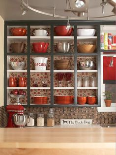 Keep your shelves open to create a fun way to keep your kitchen organized! More kitchen cabinet ideas: http://www.bhg.com/kitchen/storage/how-to-organize-kitchen-cabinets/?socsrc=bhgpin101113openkitchencabinets&page=6