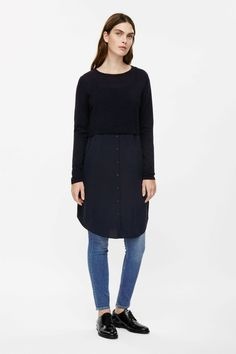 Designed for a contrast of textures, this knitted merino dress has a lightweight silk skirt with a button detail along the front. A loose, relaxed fit, it has a ribbed round neckline, long sleeves and a softly curved hemline.