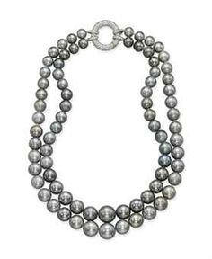 Jewels for Hope: The Collection of Mrs Lily Safra A CULTURED PEARL AND DIAMOND NECKLACE The two strands of forty-one and thirty-seven grey graduated cultured pearls, gathered by a pavé-set diamond hoop clasp, mounted in gold.