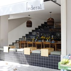 Federal Cafe The client brief for Federal Cafe, this existing two-floor building with terrace, located on a corner street in the neighborhood of San Antonio, was a cozy and informal cafe/bistro with an Australian touch, in tune with its owners' origins.