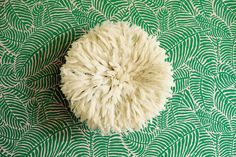 20 inch African Juju Hat from Cameroon, Feather hat on Palm Print Wallpaper.