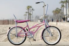 i always wanted a beach cruiser... make it a low rider bike with a white wicker basket & im one happy beach bum!