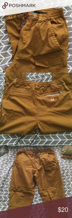 Men's Urban Outfitters Joggers Stylish men's darker tan cargo joggers from Urban Outfitters (Without Walls). Size medium, but my husband wears a 32 and they fit perfect. Worn once. Excellent condition. Urban Outfitters Pants Sweatpants & Joggers