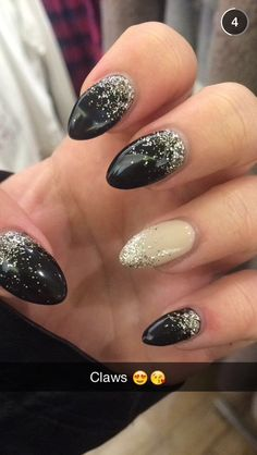 Beautiful new nails! Stiletto extensions black and cream with mixed gold and silver glitter