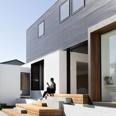 This sleek dwelling keeps its cool with passive design. Outside of Melbourne, the 4,306-square-foot, site-sensitive home by local studio @modo_arch opens up to connect with the garden and stay cool. To peek inside, click the link in bio.-Photo by Ben Hoskins@benhosking1984 #exterior #moderndesign #modernarchitecture #greendesign #sustainablearchitecture #passivedesign #indooroutdoorliving
