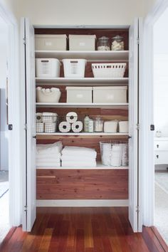How I completely transformed a linen closet using cedar planks and white melamine-coated shelves. White bins, baskets, and containers creates a beautiful contrast with the wood. closet A Cedar Linen Closet Makeover Bathroom Closet Organization, Bathroom Linen Closet, Home Organisation, Organization Ideas, Bathroom Storage, Organizing Tips, Bathroom Styling, Small Bathroom, Closets Pequenos