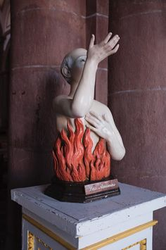 "Anima Sola translates as the ""lone soul"" or ""lonely spirit"" and refers to a very specific votive image. Based on Roman Catholic votive statues (but now a standardized chromolithograph), this image is particularly popular in Latin American magical traditions. It depicts a woman standing amidst flames, eternally burning yet never consumed. She gazes upwards, holding her chained hands towards heaven. Is her soul burning in the fire of Hell or does her heart burn with the fire of love?"