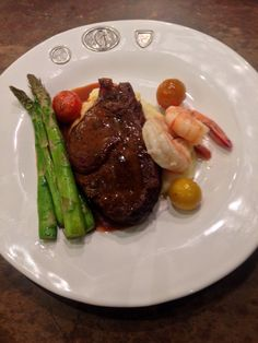 Fillet of beef w/ Marsala cream sauce, garlic Yukon gold mashed potatoes, grilled asparagus, roasted heirloom tomatoes