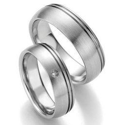 Trauringe Arlington  Edelstahlringe  Damenring mit 1 Diamanten, 0,02 ct,  Ringbreite Dr: 6,0 mm; Hr: 7,0 mm,  Stärke: Dr: 1,8 mm, Hr: 2,0 mm,  Oberfläche: strichmattiert, Rillen poliert