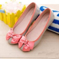 Tan flats with coral bow and trim