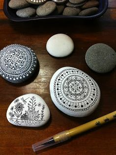 sharpie drawing on white rocks. I want to put these in an indoor fountain