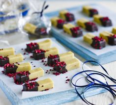 Buttery fudge is spiked with fragrant cardamom then dipped in dark chocolate - sprinkle with freeze-dried raspberries for extra flavour