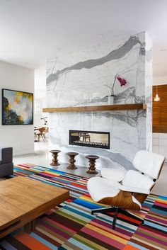 Marble fireplace, white Eames Chair.  Beautiful Midcentury Modern