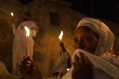 Orthodox Easter: Ethiopian Orthodox worshippers hold candles in Jerusalem's Old City