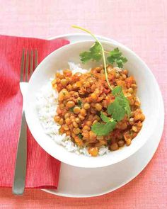Begin with canned lentils and your favorite bottled tomato sauce to assemble this vegan meal in just 20 minutes. Ginger, curry powder, garam masala, lime juice, and fresh cilantro add lively flavor to the dish.