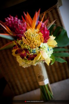 Tropical flower bouquet made of Ginger, Pincushion, Birds of Paradise, Cymbidium Orchids and Monstera Leaf