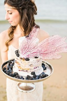 Red, white, and blue organic wedding cake for a beach wedding