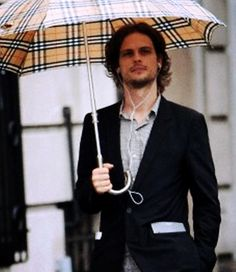 Oh my, I want that umbrella! It will look fabulous with my matching scarf. I'd like him too...