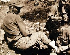 Korean War: At What Cost. HM3 William Haney, USN, treats a wounded U.S. Marine in his fox hole on Hill 1040, somewhere in Korea. Photographed by Lieutenant Junior Grade H.H. Searls, June 10, 1951. U.S. Navy photograph, now in the collections of the National Archives.