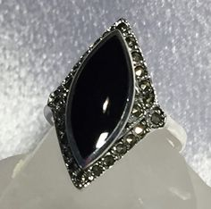 Beautiful Solid Sterling Silver Black Onyx ring with a Marcasite edge. Black onyx has a marquis shape and measures x mm. Available in size 6 and Comes packaged in a box suitable for gifting. Diamond Wedding Bands, Halo Diamond, Sterling Silver Necklaces, Silver Rings, 925 Silver, Swarovski, Marcasite Jewelry, Black Onyx Ring, Garnet Rings