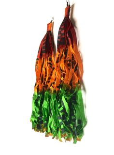 Embrace your Bohemian side with these extra long, free-flowing Ankara fabric earrings made with a beautiful colorful African print. Funky, bold and fun! This 9-inch pair hang by black plated copper earwires.  Nickel &  Lead Free  SHIPPING NOW ONLY $1 (within the U.S. only)