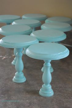 DIY mini cake stands - wood craft circles plus wood candlestick   Great display pieces for parties or crafts.