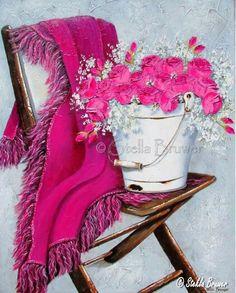 Stella Bruwer white enamel bucket on brown wooden camp chair Rosie pink throw and bright pink flowers