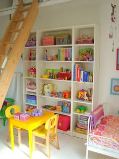 white kids room with colorful details- another good storage unit example for their bedroom