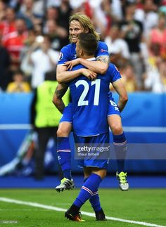 Birkir Bjarnason of Iceland celebrates with goalscorer Arnor Ingvi Traustason of Iceland during the UEFA EURO 2016 Group F match between Iceland and Austria at Stade de France on June 2016 in Paris, France. Uefa Euro 2016, 2016 Pictures, Ways To Be Happier, World Football, Attractive Guys, Iceland, Austria, Soccer, June 22