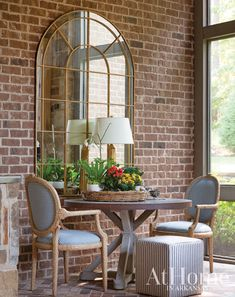 After working with the former owners of this Little Rock home—and falling in love with its bones—designer Mona Thompson bought the residence and reimagined it as her own. Neutral Walls, White Walls, Outdoor Spaces, Outdoor Living, Outdoor Decor, Sunroom Decorating, Sunroom Ideas, Decorating Ideas, Built In Wine Rack