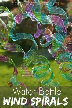 Water Bottle Wind Spirals - a gorgeous (and super-easy) way to upcycle some water bottles into a colourful ornament for the backyard or patio.  You should see the way these dance and bounce in the wind!  They're beautiful!