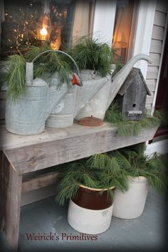 Christmas at the Weirick's........our front porch Christmas Winter decor. primitive. antiques. crocks. old birdhouses. greens. decor https://www.facebook.com/pages/Weiricks-Primitives/182707055133836