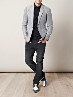 black pants and shirt with grey suit jacket.