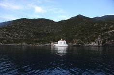 St. George Church in a cove secluded from the main beach of Poulithra.