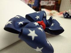 Stars on Navy Blue Bow by RazzBerryRuffles on Etsy