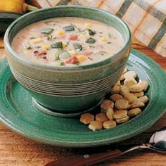 Zucchini Garden Chowder Recipe.  I just made this.  Did a chunky puree with my immersion blender and am going to use it as a base for winter chicken wild rice soup.  Great flavor, adding cooked wild rice and chicken should be delicious this winter--long after my zucchini coman has passed!