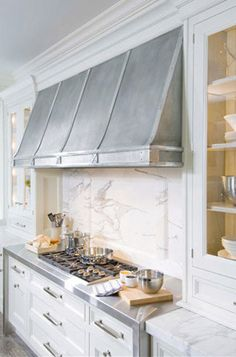 Stainless wrapped cooktop and hood #white #kitchen #design