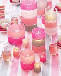 DIY baby shower centerpiec with striped candleholders.