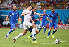 Steven Gerrard of England is challenged by Gabriel Paletta of Italy during the 2014 FIFA World Cup Brazil Group D match between England and Italy at Arena Amazonia on June 14, 2014 in Manaus, Brazil.