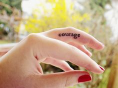 Finger tattoo 'courage'