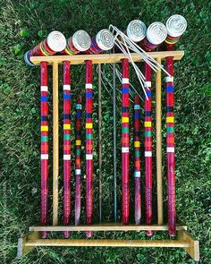 #rainbow #vintage #croquet in #ScituateMA  This #stockphoto is available via Stocksy United search: #raymondforbesllc  #croquet #croquetclub #mallet #grassy #grass #croquetclubs #vintagesports #vintagesport