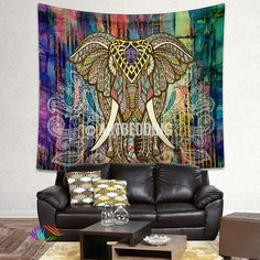 """Looking for that special piece of home décor to transform your room from ordinary to extraordinary? A tapestry is so much more than a simple home décor item; it is a work of art. Dress up your wall, bed, chair or use it on the go. This unique piece of ethnic art """" Colored elephant in zentangle style on a grunge bright colors painted background with traditional Indian design elements """" can be used in different ways as tapestry, wall hanging, Bedspread, Bed Cover, Table Cloth, Sofa co..."""