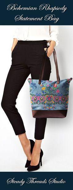 Buy this ultimate statement bag. Custom designed and embroidery inspired artwork. Large designer canvas handbag with cowhide detail, inner zip pocket, and top zipper closure. #statementbag #designerhandbag #canvasbag