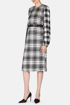 Francisco Costa continued his thoughtful exploration of print for Calvin Klein's fall 2016 collection, artfully mixing plaids in pieces such as this fluid silk dress. Designed to be cinched by its low-slung belt, the relaxed silhouette is sharpened by slits: adjust their depth with the contrast buttons. A back zipper closure ensures a smooth fit.