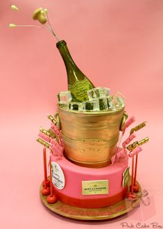 Cake in Shape of Champagne Bottle in Bucket with Ice
