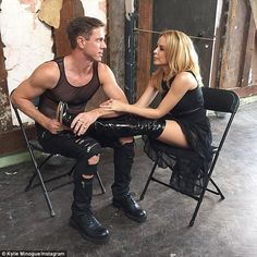 A bit of attitude: Kylie Minogue showed off her cheeky side on Wednesday as she dressed in a sheer black skirt and leather boots while she cosied up to Jake Shears