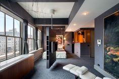 modernes design schlafzimmer wohnung grau raumteiler tv drehbar