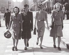 Eisenhower jacket from 1930s, based on military jacket that were similar to bolero suits that ended above the waist. (the second woman from the right)