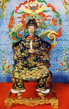 """Vua Khải Định - Sa Majesté Khai Dinh, Empereur d'Annam - 1919    The Emperor of Annam, Vietnam. As the Son of Heaven, the emperor is dressed in his ritual robes and holds in his hands the sacred """"rule,"""" a tablet of wood. Illustration from a 1922 book.--- Image by © The Print Collector/Corbis"""