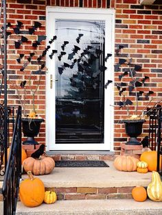 Decorate your front door with bats for Halloween. More ideas @BrightNest Blog